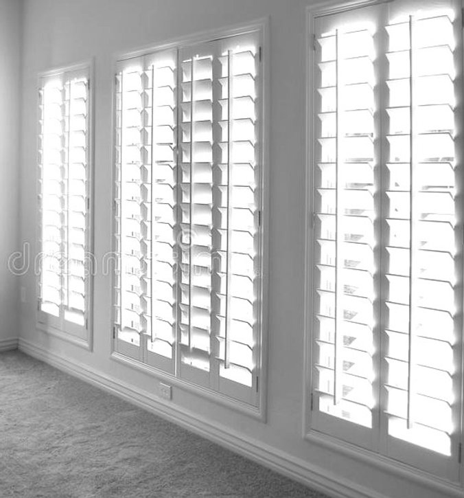 white-plantation-style-wood-shutters-26958837_edited_edited.jpg