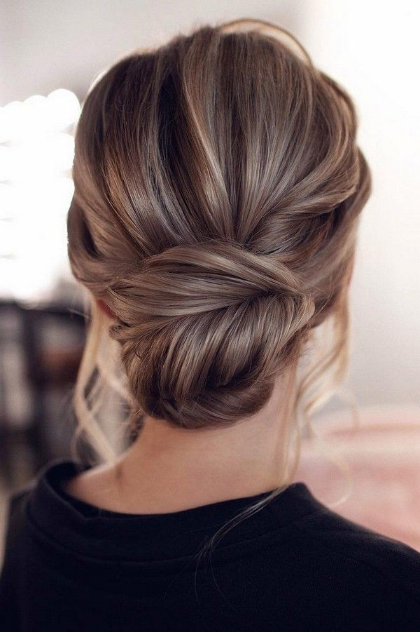 low chignon bun for weddings and brides