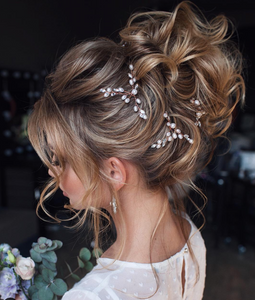 classic high bun hairstyle best for brides and bridesmaids