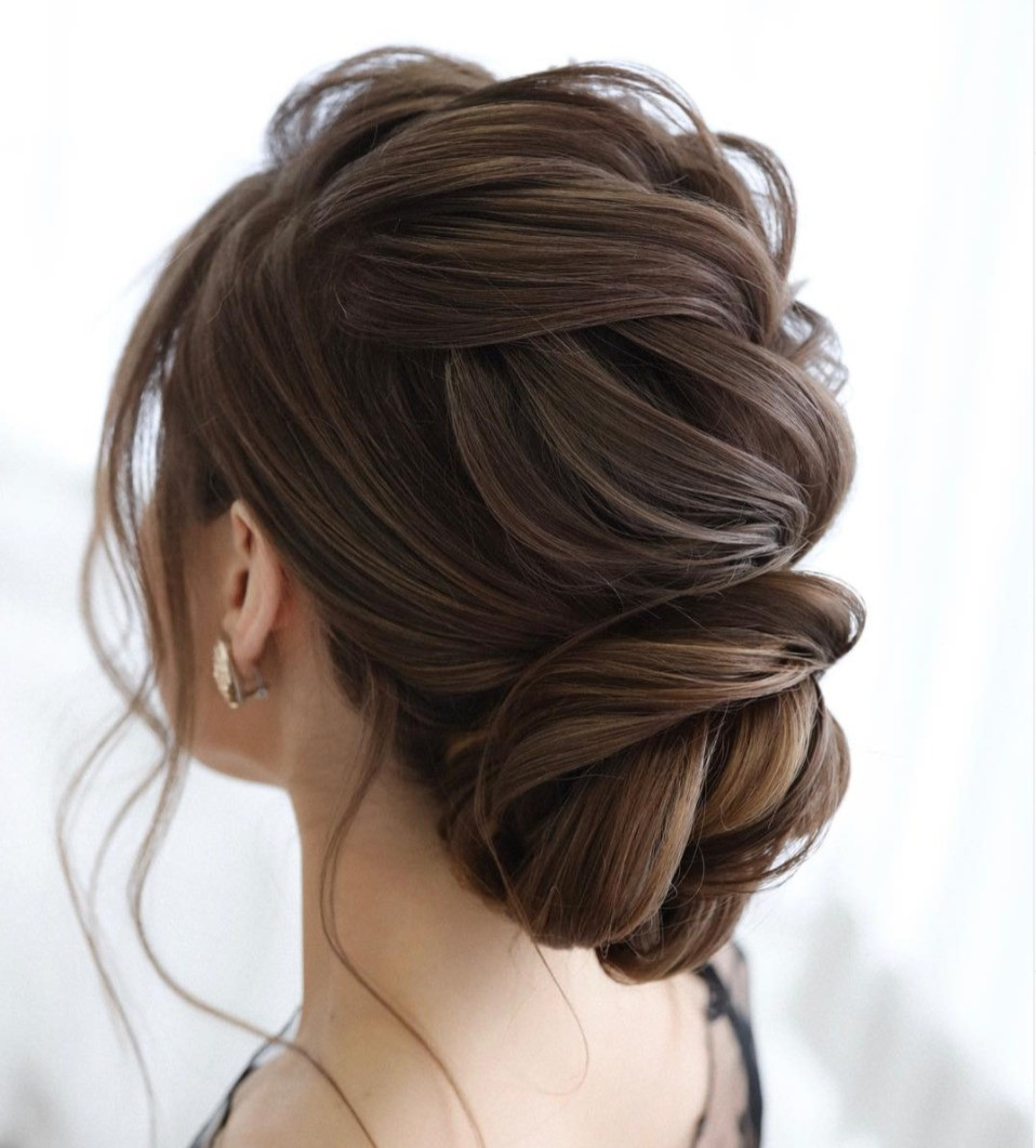 Textured braided twisted hairstyle for brides