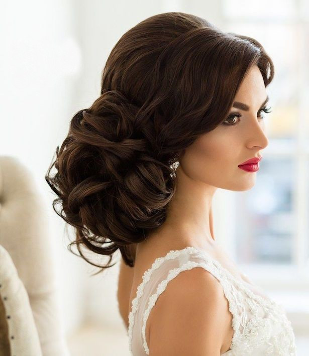 popular low bun hairstyle for weddings bride bridesmaids