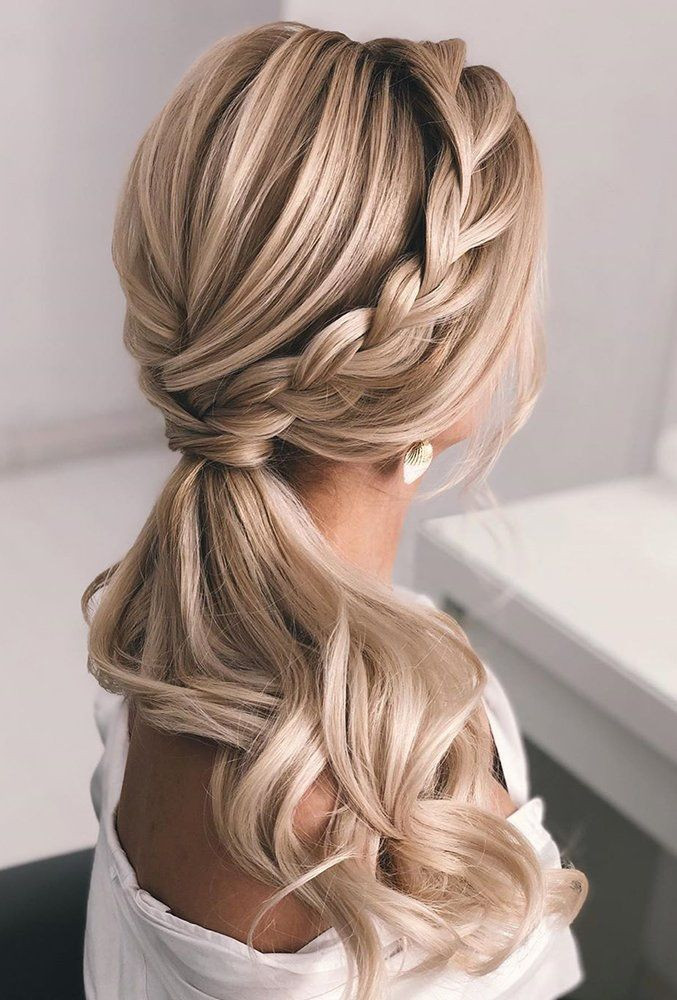 Low pony and curls hairstyle for weddings