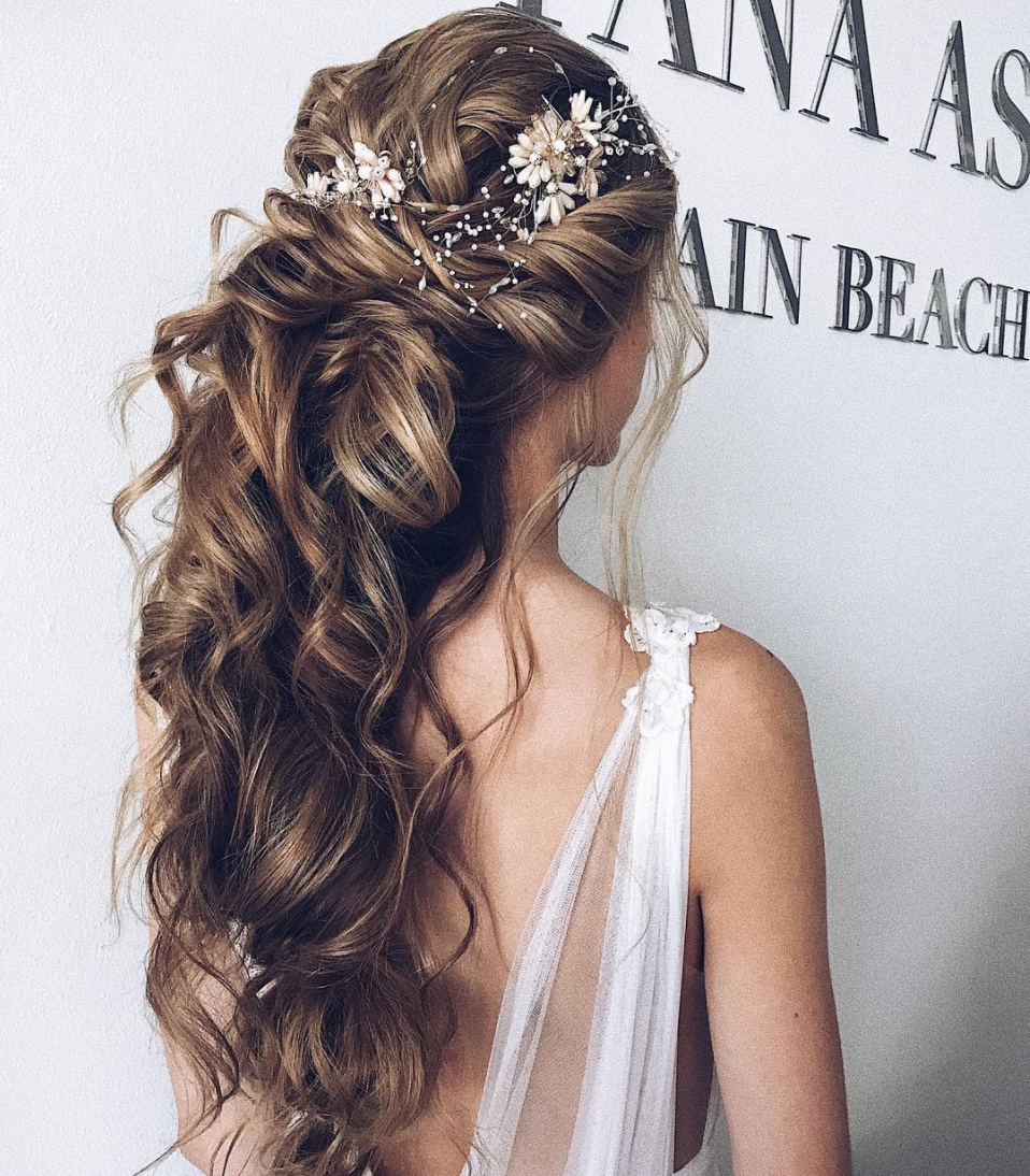 Curls and half up half down hairstyle for bridal long hair