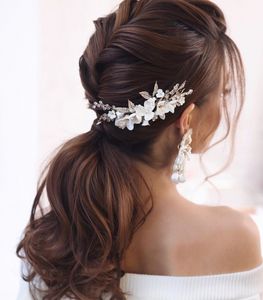 Low ponytail hairstyle for long hair weddings