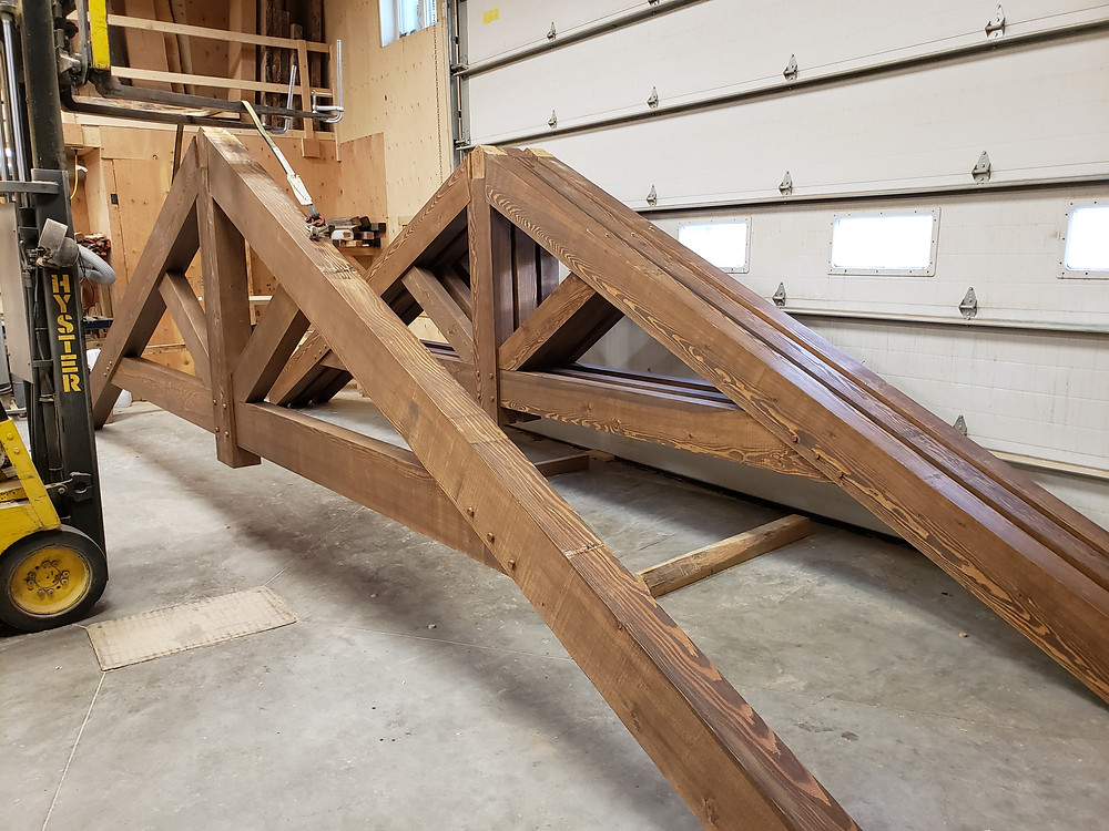 An image of timber trusses for a previous project when they were still sitting in the Timber Master's shop.