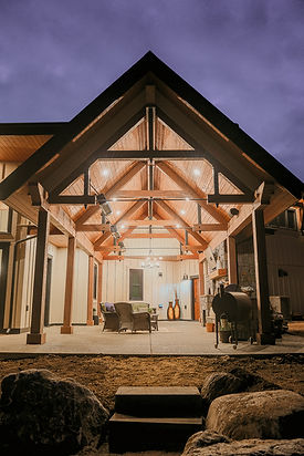 outdoor porch patio with vaulted roof line and timber frame, wood planking ceiling.