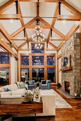 luxury timber frame home with vaulted ceiling and wood accents