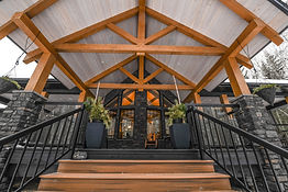 timber frame accents on a back porchove a deck with a vaulted ceiling