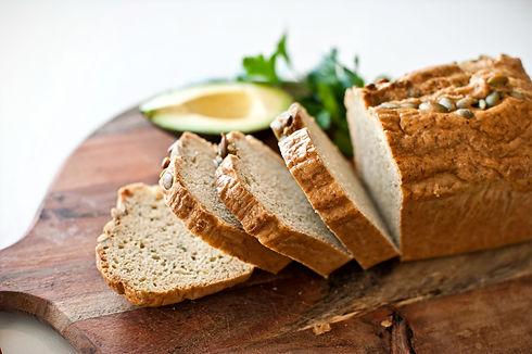 keto bakery sliced gluten free bread on a board <img>