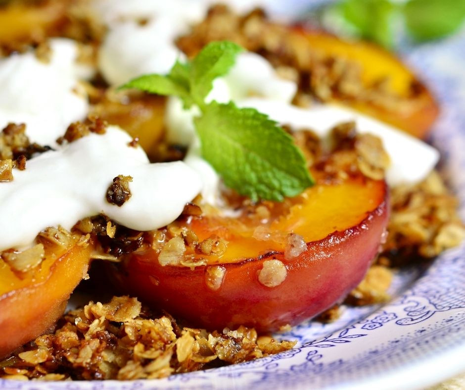 Baked Peaches with Granola and Whipped Cream