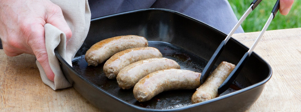 paleo sausages frying in a pan at christ
