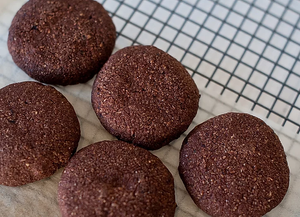 5 triple choc keto cookies drying on parchment paper