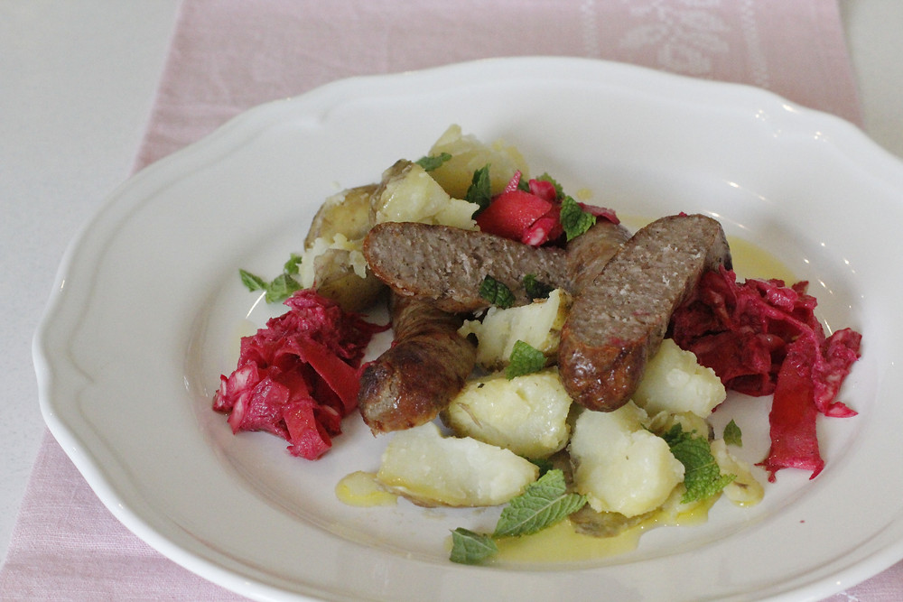 sausage with beetroot coleslaw and potatoes
