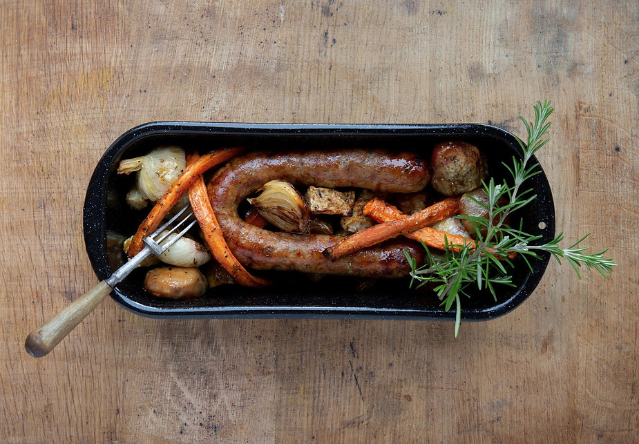 real food roasted bratwurst onion and sweet potato strips