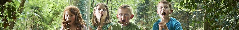 children eating real food sausages