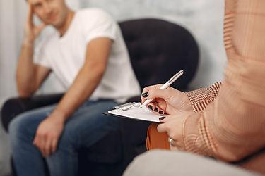 man-sitting-psychologist-s-office-talkin