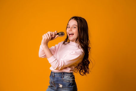 baby-girl-with-microphone-smiling-singin