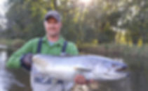Greg Williams holding trout fish from Cumberland River.