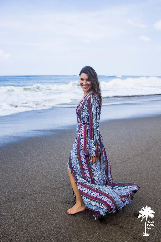 purple grey gypsy dress bell sleeves bali beach photoshoot under a palm tree