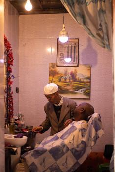 barber shaving customer marrakech, medina, hair dressers,