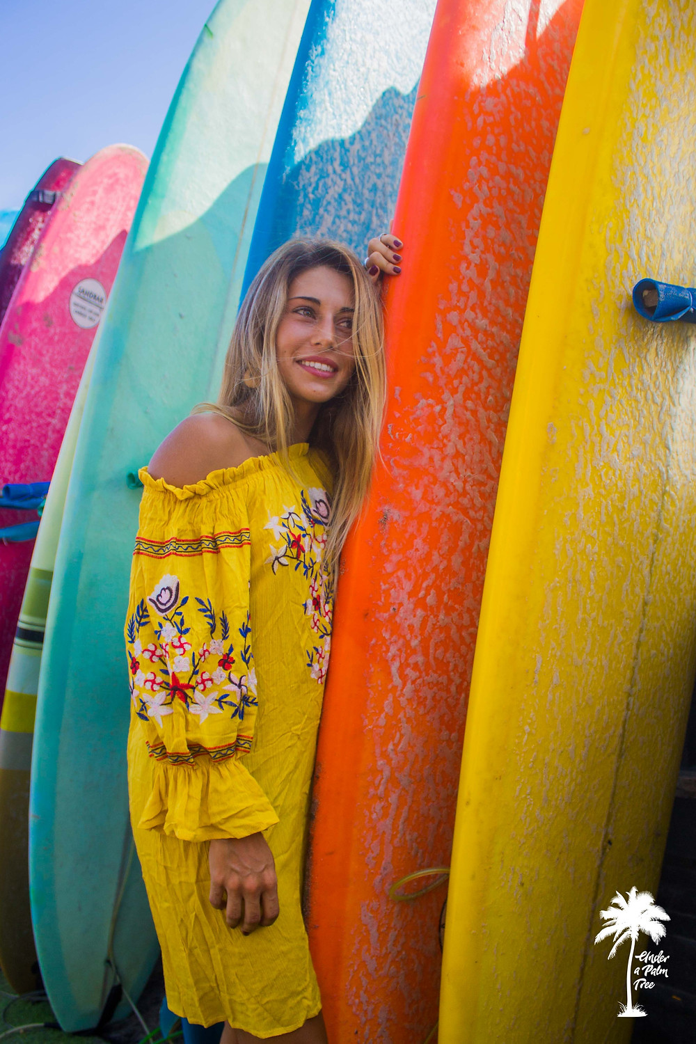 colourful surfer board yellow dress model photoshoot