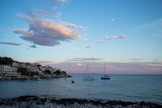 hvar croatia pastel sunset boat coastline travel photographer, under a palm tree photography
