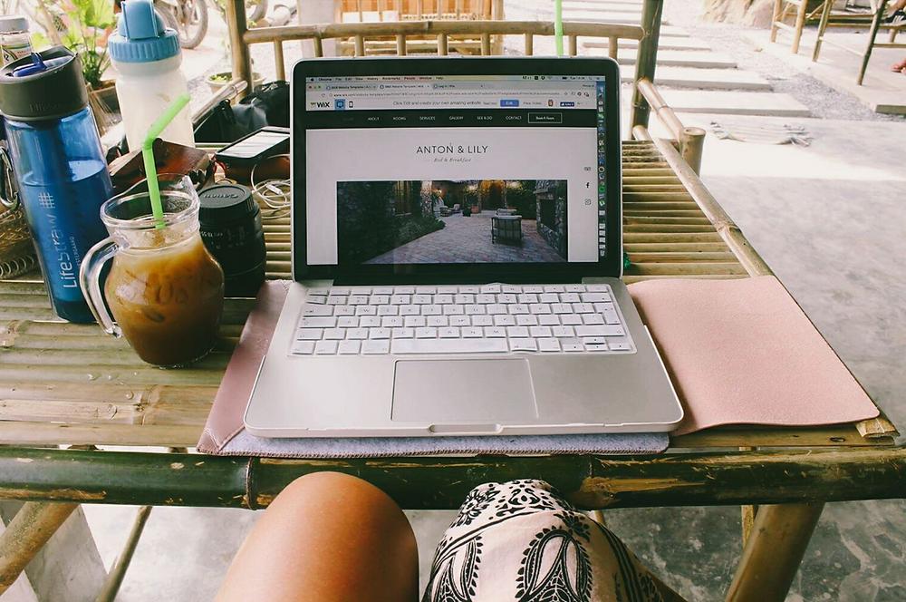 Office necessities: MacBook Pro, Canon, LifeStraw & Iced Coffee