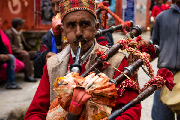 indian wedding procession man with bagpi