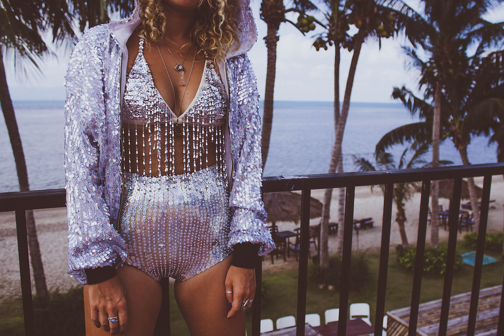 lady jane bristol sequin playsuit beach lookbook campaign under a palm tree photography silver sequins