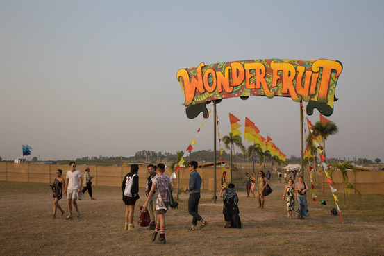 wonderfruit festival sign pattaya thailand event photographer under a palm tree