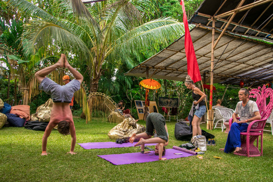 bali spirit festival, yoga, acroyoga, event photography, under a palm tree