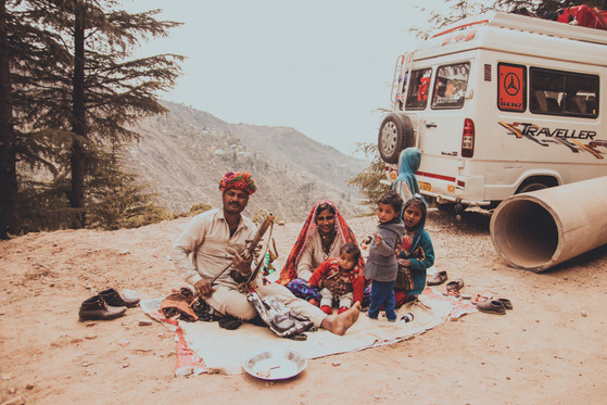 indian family with children performing h
