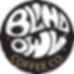 blind owl coffee under a palm tree