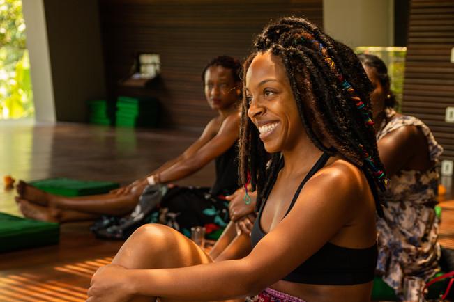 woman smiling, glow up goddess, retreat, ubud, maya resort, womens healing, event photography, under a palm tree