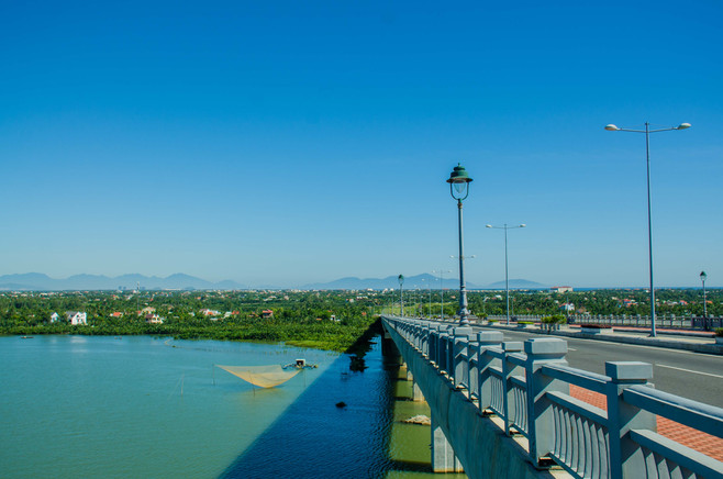 hoi an, vietnam bridge, mountains, river, landscape, travel photography, under a palm tree photography