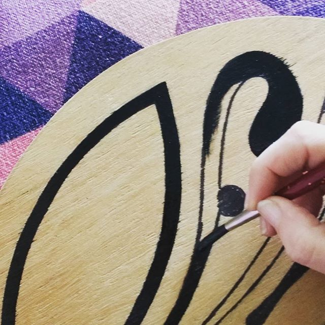 Painting my logo in oil paint on timber.