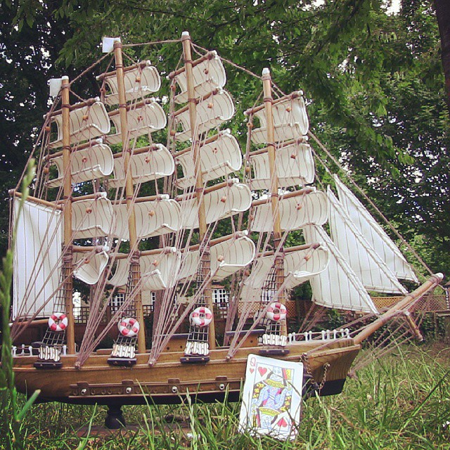 A ship. Safe in a harbor. Safe in the grass._A playing card. A playing #ship. _A tumultuous and tend