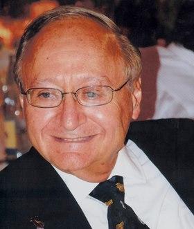 Dr. Mervyn Deitel , the Director