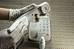 Cleaning staff cleaned public telephone