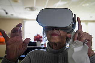 woman wearing VR headset, reaching out