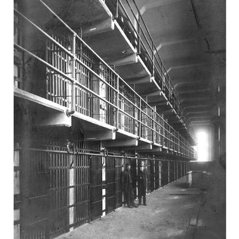 Two men standing in the newly completed Alcatraz cell block D, March 20, 1911