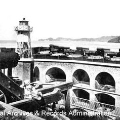 Cannon stand ready on the barbette tier in 1870. PARC, Golden Gate National Recreation Area. (FortPointBarbetteTier