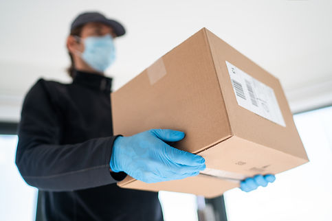 Home delivery shopping box man wearing g