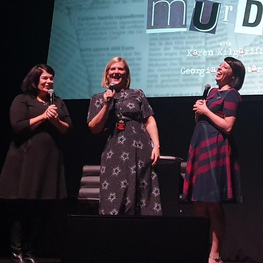 Karen Kilgariff, Olivia Standbridge and Georgia Hardstark on stage at the Hammersmith Apollo laughing