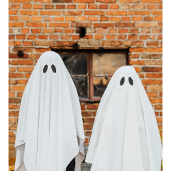 Two people wearing white sheets dressed as ghosts