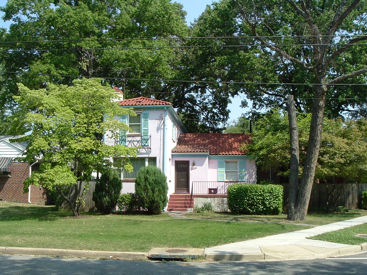 A unique Eastland Gardens house, Pink stucco with a clay tile roof.