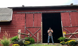 cropped-Colin-in-front-of-Barn-on-Openin