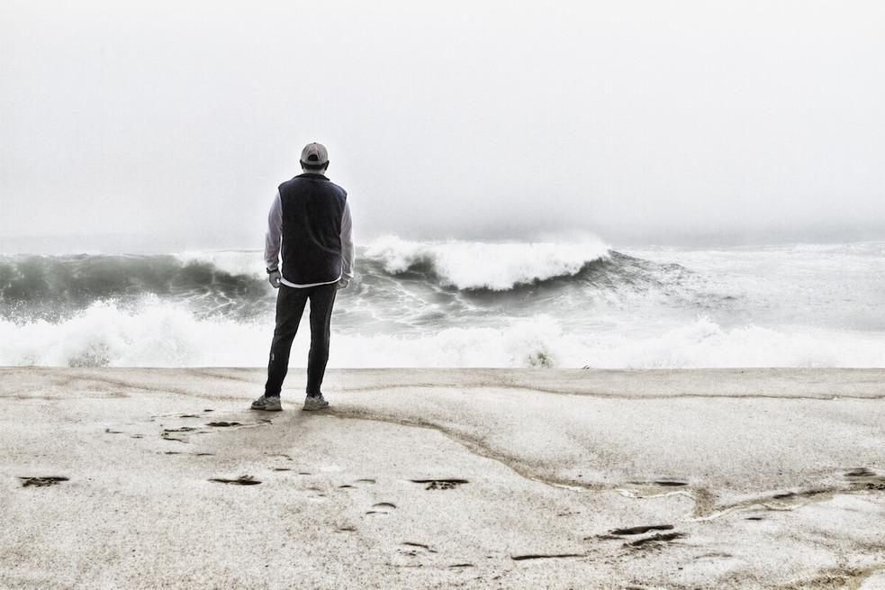 Man Staring at Ocean