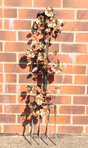 Garden fork with copper and brass dog roses