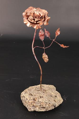 Single rose in stone
